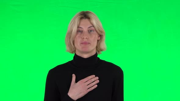 Thumbnail for Blonde Guy Indignantly Talking To Someone, Looking at the Camera. Green Screen