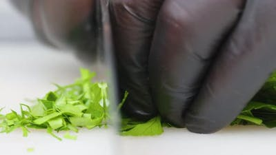 Chef Cuts Vegetable with Kitchen Knife