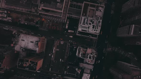 Thumbnail for AERIAL: Overhead View of Skyscraper Building Rooftops in Manhattan New York City at Dawn After