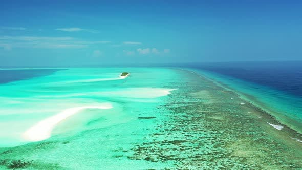 Thumbnail for Daytime fly over tourism shot of a white sand paradise beach and aqua turquoise water background