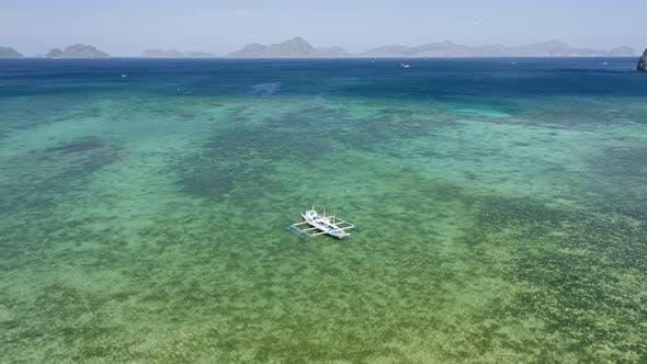 Thumbnail for Aerial View of Filipino Boats Moored in Shallow Lagoon Bay Near El Nido Village. Bacuit Bay, Palawan