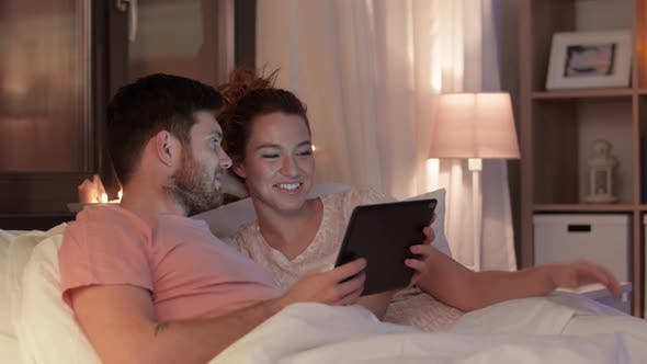 Thumbnail for Happy Couple Using Tablet Computer in Bed at Night 25