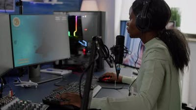 African Woman Streamer Cyber Putting on Headphones
