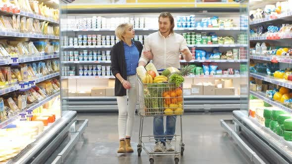 Thumbnail for Couple in a Supermarket Shopping with a Shopping Cart Buying Groceries