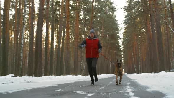 Thumbnail for Man Jogging with Dog on Winter Day