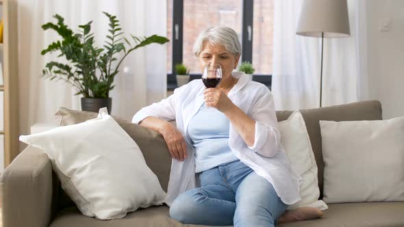 Thumbnail for Senior Woman Drinking Red Wine From Glass at Home