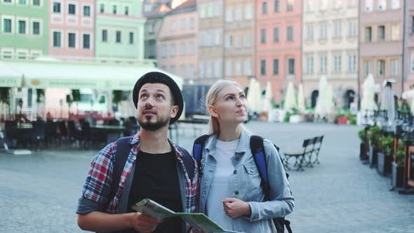 Tourists Looking on Main Tourist Attractions Using Map