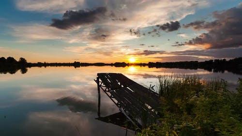 Timelapse of Old Fishing Bridge on the Lake at Sunset