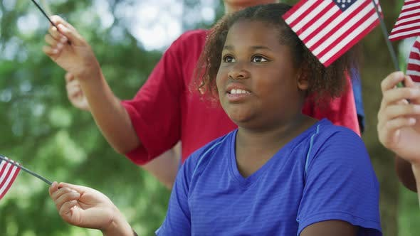 Thumbnail for Kids waving flags on Fourth of July