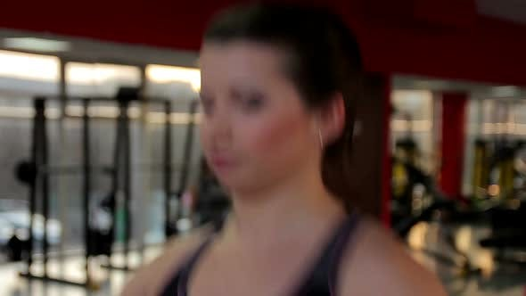 Thumbnail for Hot Brunette Taking Care of Her Fit Body, Exercising on Treadmill in the Gym