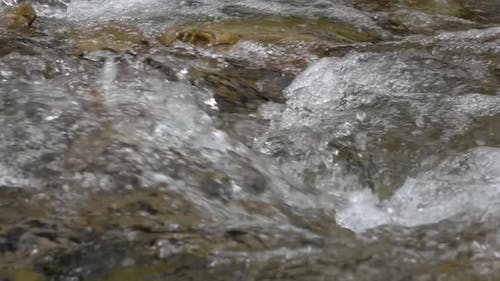Closeups of Pure Stream of Mountain River in Slow Motion