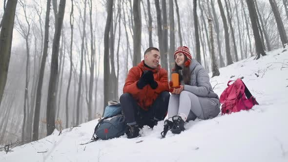 Thumbnail for Couple Talking While Sitting in Forest