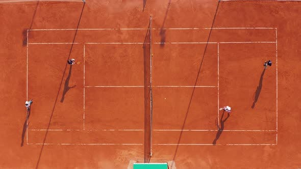 Thumbnail for Aerial View Players Are Playing Tennis on Orange Court
