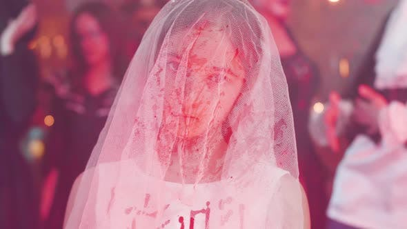 Thumbnail for Teenage Girl Disguised As a Dead Bride Covered in Blood with a Knife in Her Hand