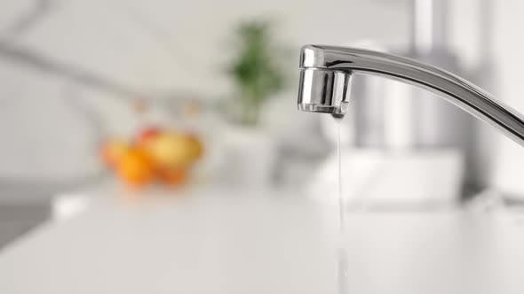 Water Dripping From Faucet Tap at Kitchen