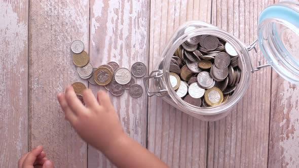Child Girl Pile Coin for Saving.