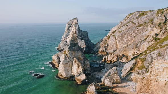 Thumbnail for Aerial Circle Fly Around Rocky Cliffs of Praia Da Ursa Beach Located on Atlantic Coast in Sintra