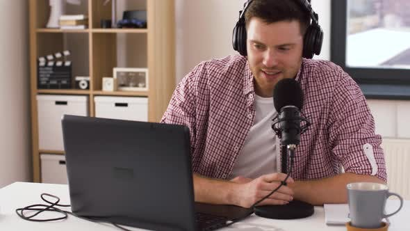 Thumbnail for Man in Headphones with Laptop Speaks To Microphone 28