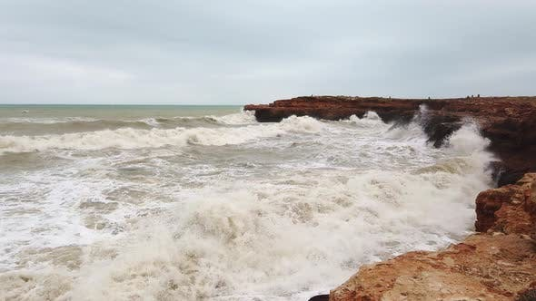 Thumbnail for Rough Sea And Large Waves Lash Rugged Coastline