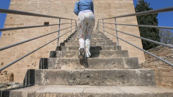 Thumbnail for Woman Tourist Is Walking Up on Stair of Kolossi Castle, Medieval Fortress on Cyprus