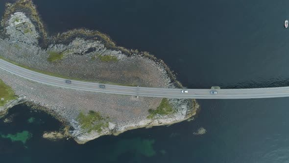 Cover Image for Cars Are Going on Atlantic Ocean Road in Norway. Aerial Vertical Top-Down View