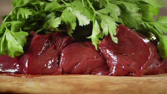 Raw Liver with Greens Slowly Rotates