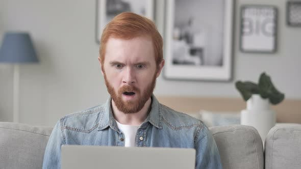 Shocked Creative Beard Man Working on Laptop, Astonished
