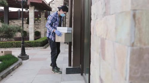 Man Contactless Delivers Parcel at Home Doorstep Knocks on Doors and Come Away