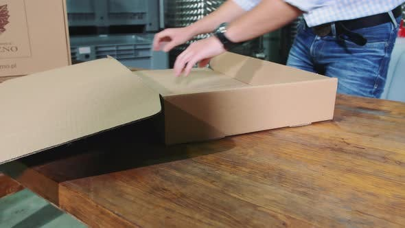 Thumbnail for Man Folding Cardboard Box