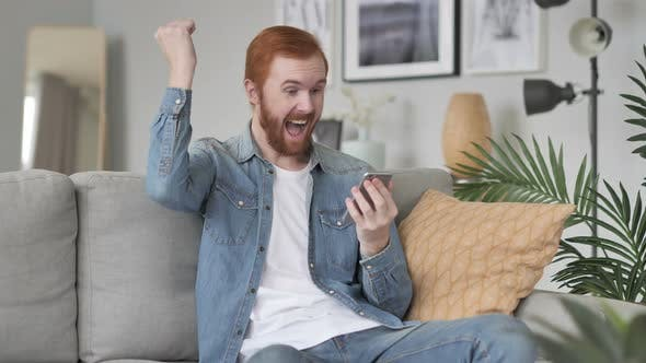 Thumbnail for Excited Man Celebrating Success on Smartphone