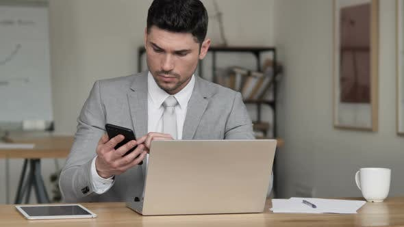 Thumbnail for Businessman Using Smartphone and Laptop