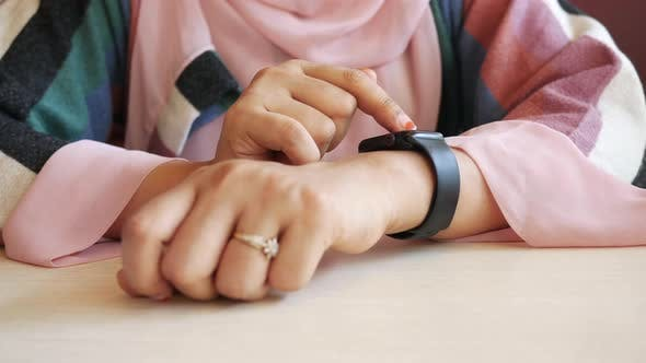 Women Hand Checking Time on Smart Watch