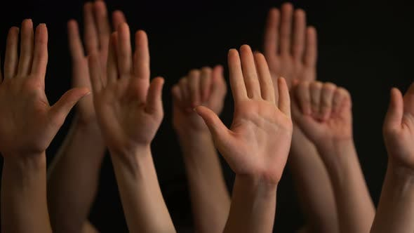 Thumbnail for Raising Hands on Black Background