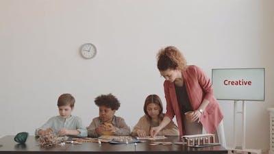 Woman Teaching Children on Workshop