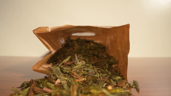 Green Tea Scattered on the Table