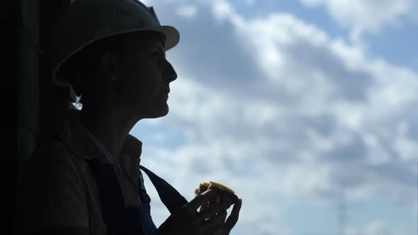 Thumbnail for Construction Site Female Worker Eating a Tasty Sandwich in Working Lunch Time