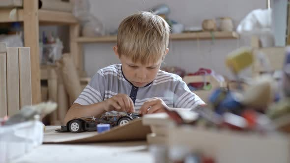 Thumbnail for Boy Fixing Toy Car