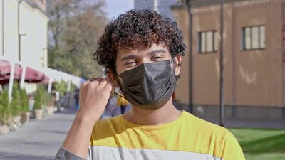 Man wearing protective face mask.