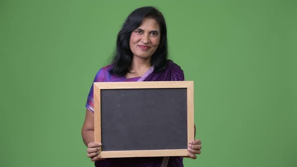 Cover Image for Mature Beautiful Indian Woman Showing Blackboard