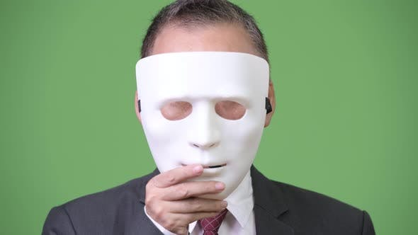 Thumbnail for Mature Japanese Businessman with White Mask As Concept
