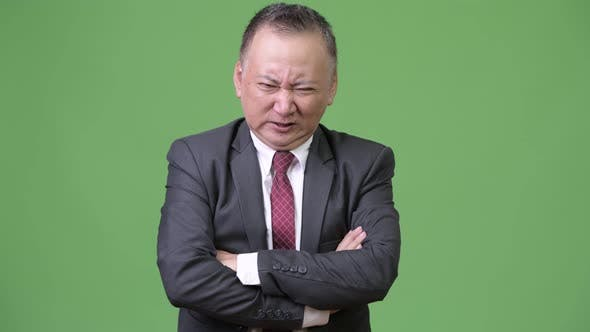 Thumbnail for Mature Japanese Businessman Looking Angry