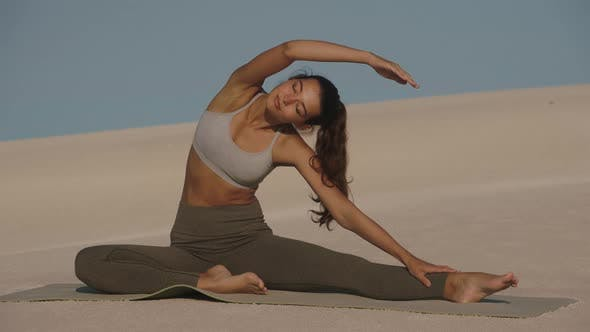 Woman Stretching After Fitness Outdoors
