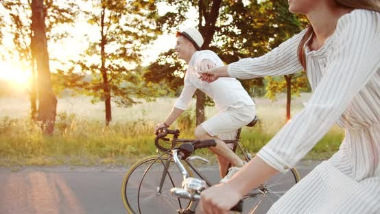 Thumbnail for Lovely Couple Riding Bicycles and Holding Hands