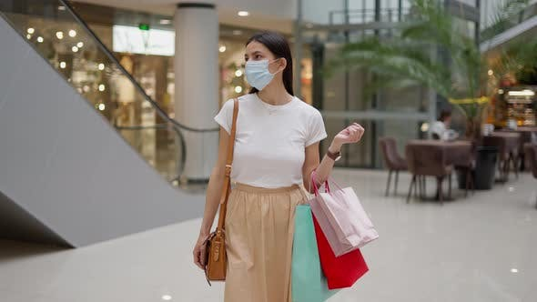 Attractive Woman in Protective Face Mask on Shopping During Pandemic
