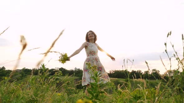 Thumbnail for Happy Smiling Girl With The Bouqet At The Evening Meadow