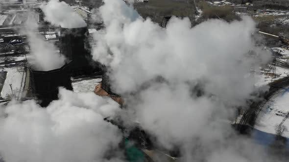 Thumbnail for Flying Over the Plant Producing Thermal Energy with Large Pipes. Aerial Shot. Eclolgy Problem
