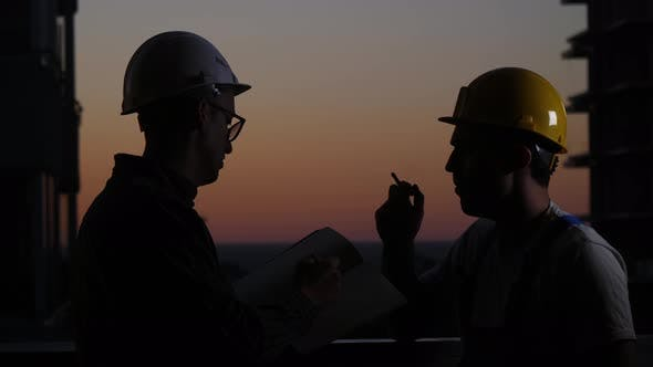 Thumbnail for Construction Workers Having Discussion at Sunset. One Smokes.