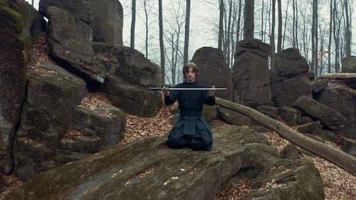 Ninja Katanas with a Samurai in a Coniferous Forest