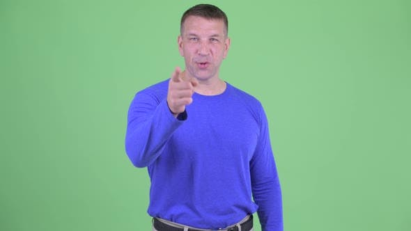 Thumbnail for Happy Macho Mature Man Pointing at Camera