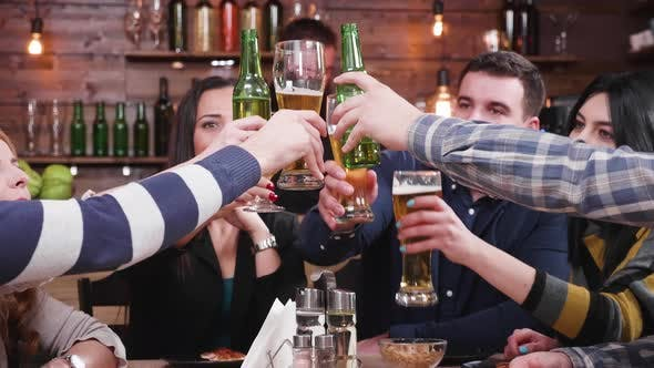 Thumbnail for Big Group of Happy Friends Laughing and Clinking Their Glasses with Beer